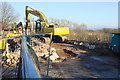 SU5588 : Demolishing the 2002 parapets of Sands Road railway bridge by Roger Templeman
