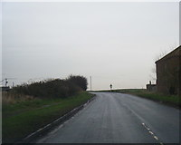 TA3719 : B1445 Main Road leaving Skeffling by Colin Pyle