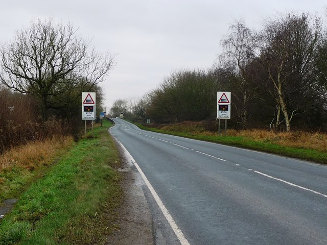 Warning of a level crossing on the A614