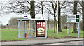 J3480 : Bus shelter and road sign, Whitehouse, Newtownabbey (January 2017) by Albert Bridge