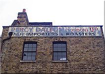 TQ3381 : Ghost sign, Spitalfields by Julian Osley