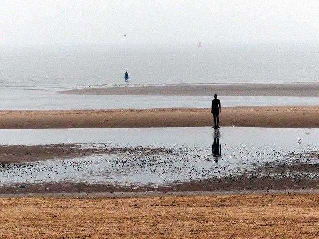 Low tide, misty morning, iron men