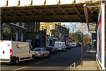 TQ2885 : Looking under the railway bridge, Highgate Road by Christopher Hilton