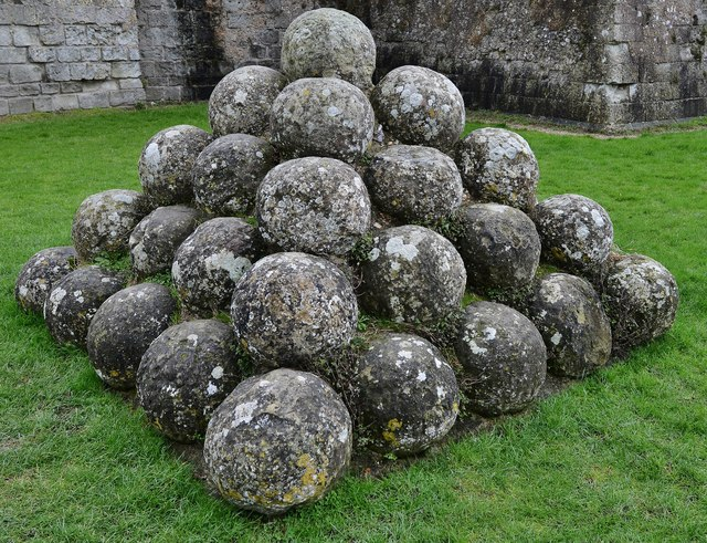 Pevensey Castle: A neat pile of stone ball trebuchet ammunition recovered from the moat