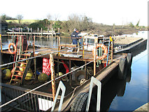 TG3204 : Dredger and barge at Rockland Dike by Evelyn Simak