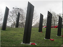 TQ2879 : Red bus passing the New Zealand War Memorial at Hyde Park Corner by Peter S