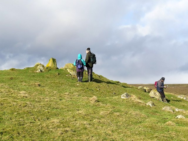 Exploring the eastern round cairn on Howden Hill