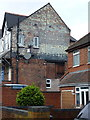 SP0590 : Ghost writing on a gable wall by Richard Law