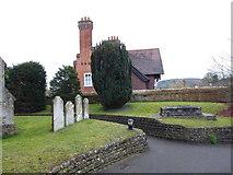 TQ0044 : Holy Trinity, Bramley: churchyard (1) by Basher Eyre