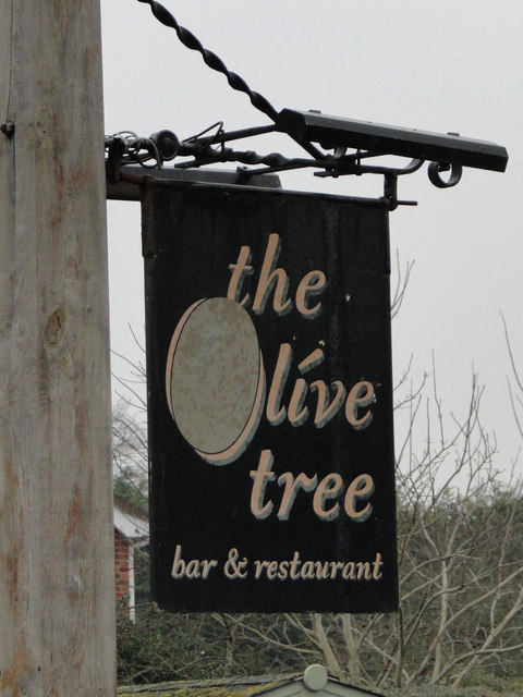 Hanging sign for The Olive Tree public house