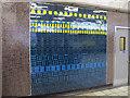 TQ3589 : Blackhorse Road tube station - ceramic tiles by Mike Quinn