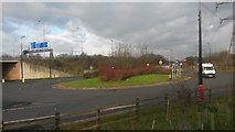 SJ8092 : Roundabout at M60 junction 6 by David Martin