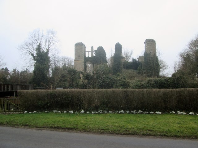 Slingsby  Castle  in  early  morning  mist  and  Snowdrops