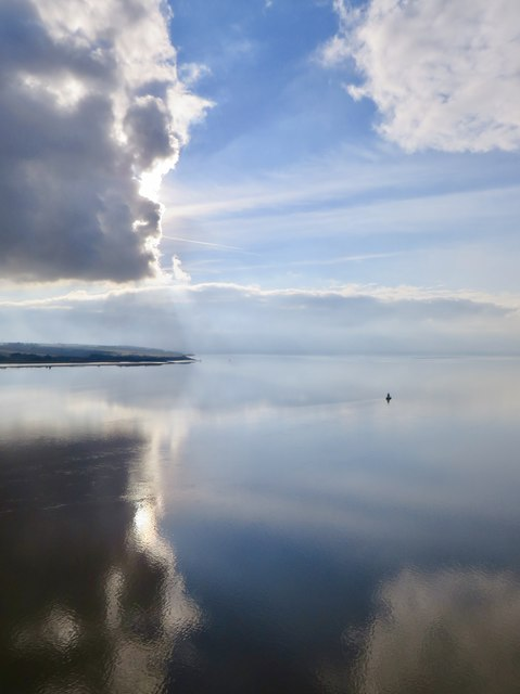 """Where sky and Lincolnshire and water meet"""