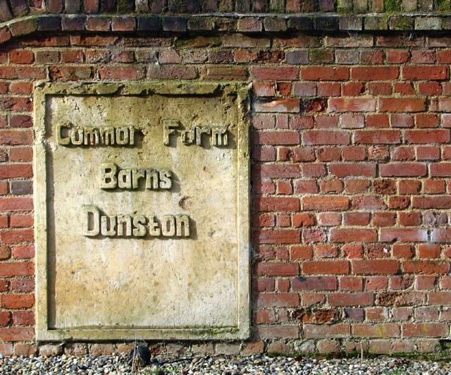 Stone plaque in the wall fronting Common Farm Barns