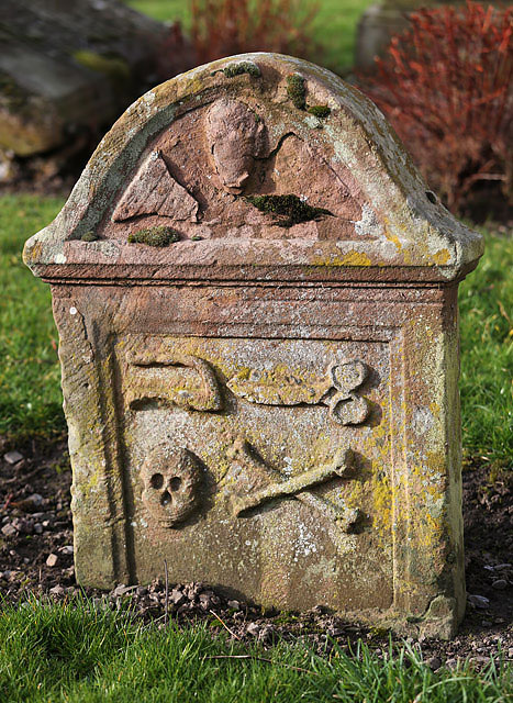 An old symbolic gravestone at St Mary's Churchyard, Hawick