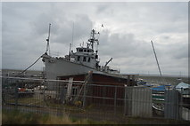 TQ8485 : Boat in dock by N Chadwick