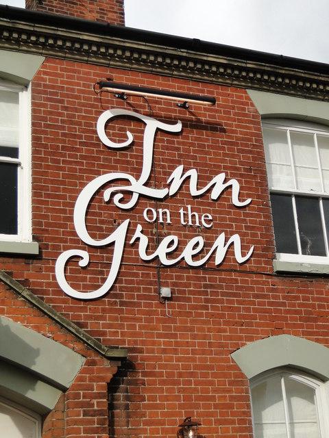 Wall sign for 'Inn on the Green' at New Buckenham