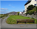 SH5800 : Roadside wooden bench in Tywyn by Jaggery