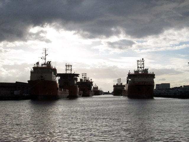 Supply  vessels  under  storm  clouds  in  Albert  Dock