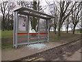 SE3532 : Temple Newsam - vandalised bus shelter by Stephen Craven