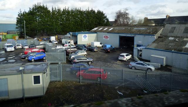 Motor yard by the railway line
