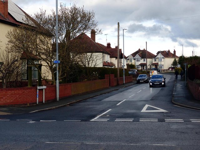 Junction of Cornmeadow Lane with Ombersely Road