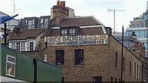 TQ3381 : Ghost Sign, Spitalfields, London by Christine Matthews