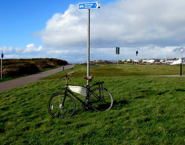 Advertising bicycle supported by a pole near Mallard Way, Porthcawl