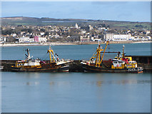 SW4628 : Fishing boats at Newlyn harbour by Gareth James