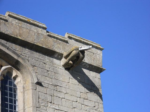 Mooning gargoyle, St. Benedict's Church, Glinton