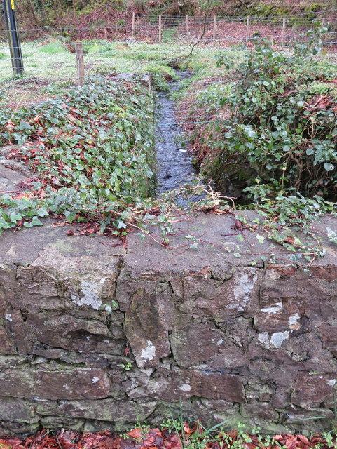 Bridge parapet and stream at Llanbedrog