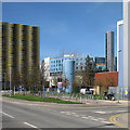 TL4654 : Coloured buildings on the Cambridge Biomedical Campus by John Sutton