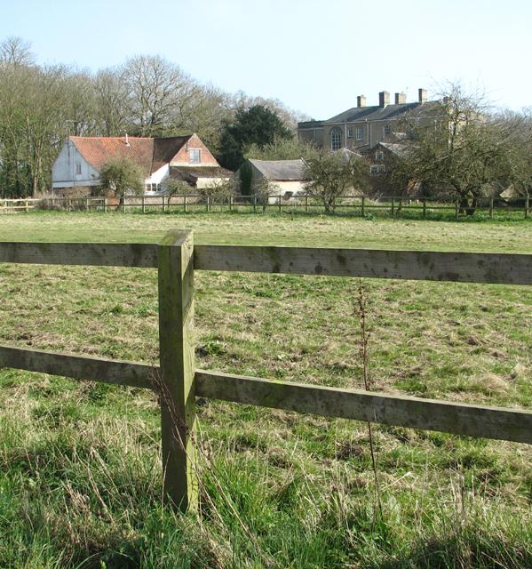 Wramplingham Hall seen across a paddock