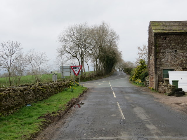 Road (B6276) being joined by road that used to be the A66 before the Brough By-pass was built