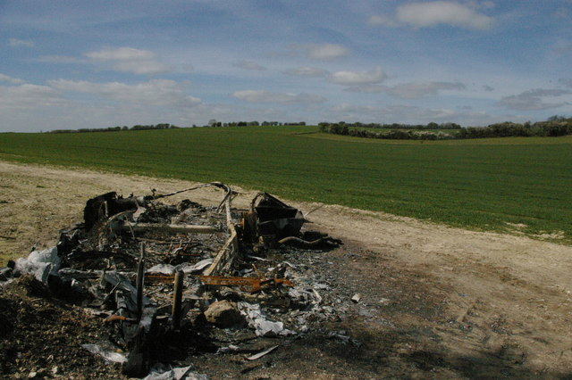 Burned-out trailer in field south of Arpinge