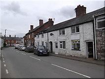 SJ1065 : Main street through Llandyrnog by Eirian Evans