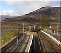NH1658 : Train leaving Achnasheen station by Craig Wallace