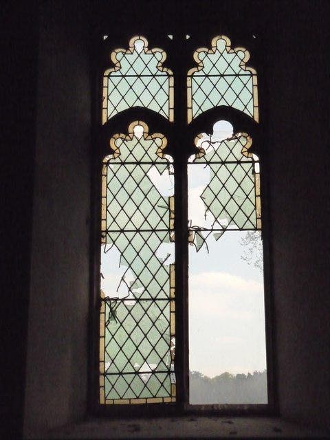 Broken stained glass window in St Andrew's, Langford