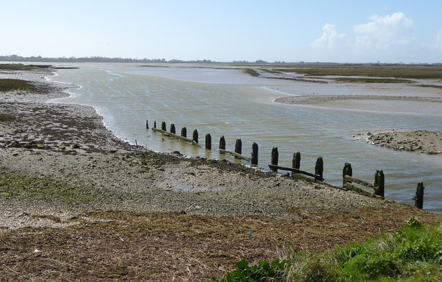 Creek and stakes; Pagham Harbour