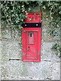 NS7177 : Disused Victorian postbox on Glasgow Road, Kilsyth by JThomas