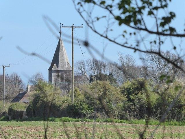 St Thomas à Becket, Pagham, seen through a hedge