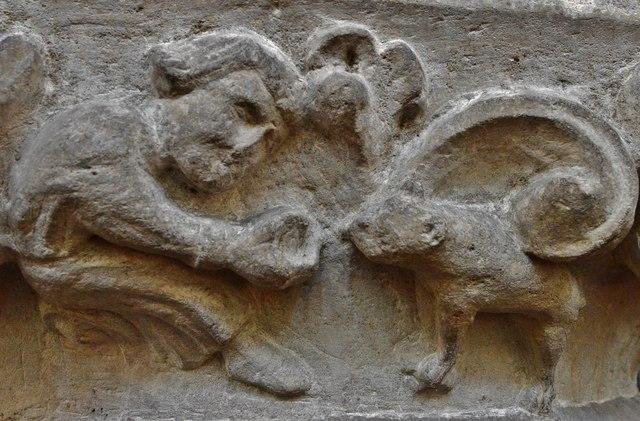 Hawkchurch: St. John the Baptist's Church: Nave capital, man feeding an animal