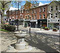 TQ2585 : Fountain and Shops, Fortune Green by Des Blenkinsopp