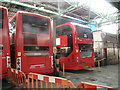 TQ3483 : View of an Alexander Dennis Enviro400 City and Scania Omnicity in Ash Grove Bus Garage #2 by Robert Lamb