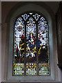TG0305 : Memorial window in Hardingham St. George church by Adrian S Pye
