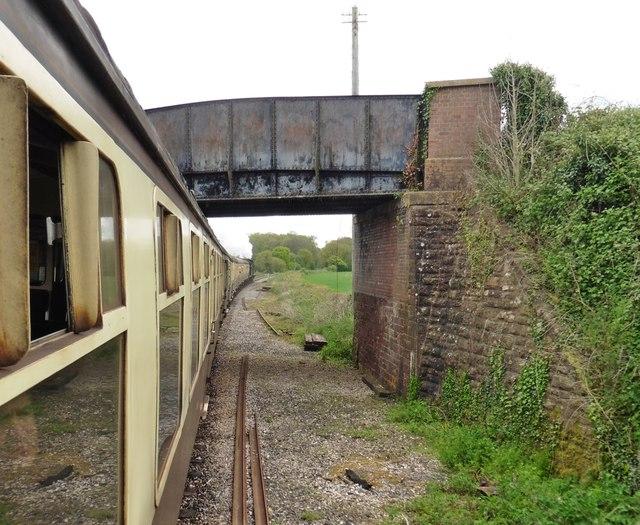 Train passing under Montys Lane