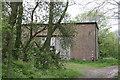 TM3294 : Former Military Building on Ditchingham Estate by Glen Denny