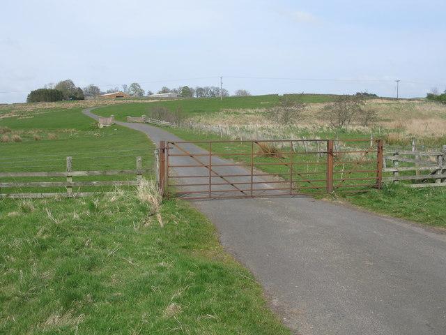 Gate across a minor road at Monkridge
