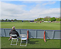 SK5566 : Welbeck Colliery Cricket Ground: the Head Coach watches approvingly by John Sutton